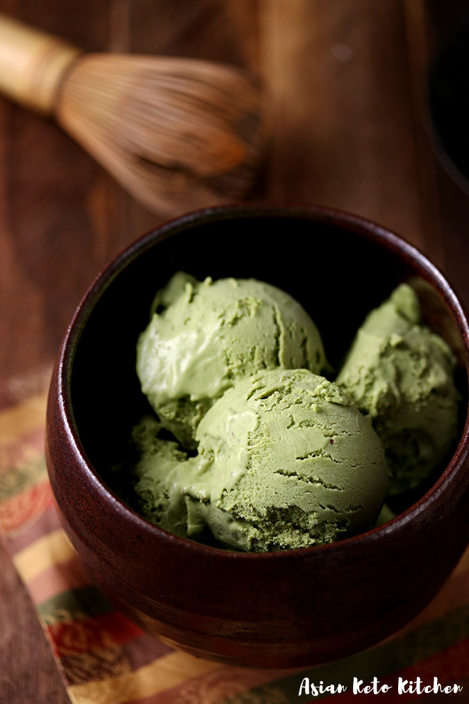 A matcha bowl filled with matcha green tea ice cream scoops.